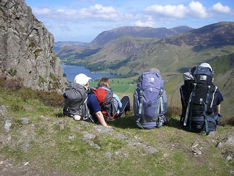 Stopping to rest and admire the view of Buttermere and Grasmoor on a wild camping expedition in the Lake District