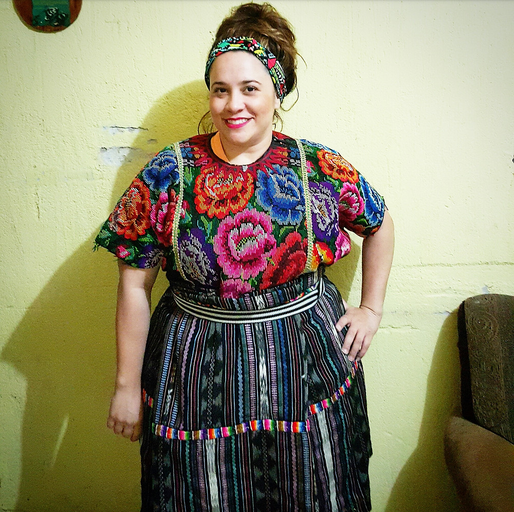 Denisse dresses in the traditional clothes while visiting Guatemala