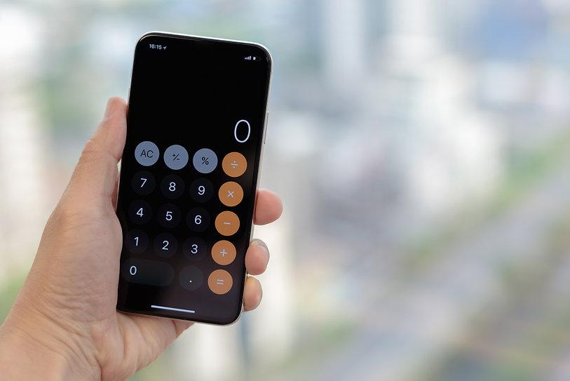 Close up man's hand open calculator app