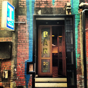 Bar American's hidden entrance with Bar signage displayed outside.