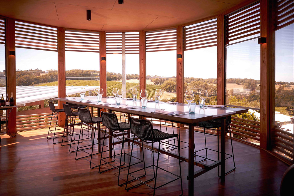 Montalto Winery dining room has a panoramic view of the vineyards through its sectioned windows.