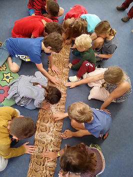 Carteton Library children exploring python skin