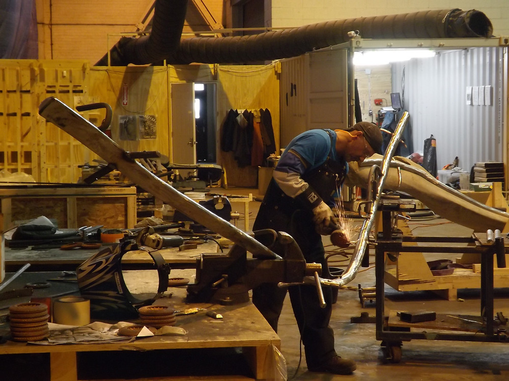 Grinding metal armature to fit the bone of the blue whale