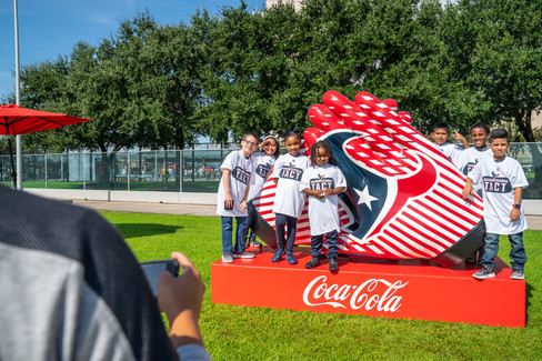 Texans_Giant_Gloves_CocaCola.jpg