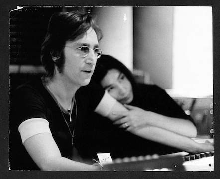 Yoko Ono leaning on John Lennon's arm The Record Plant, NYC. 1972