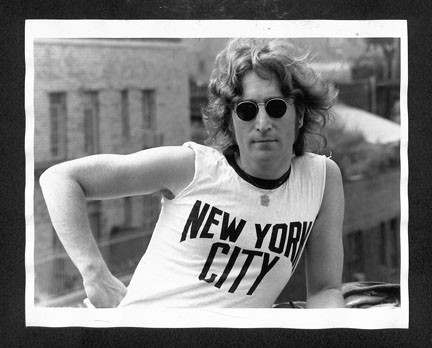 John Lennon - On Roof with NYC T-Shirt (hand on hip) NYC 1974