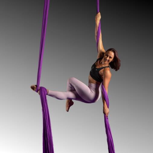 Rony Elisara hanging from aerial silk