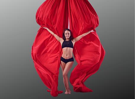 Rachel Stephens standing in front of billowing red silks