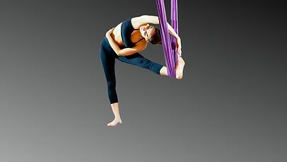 Girl stretching in aerial yoga hammock