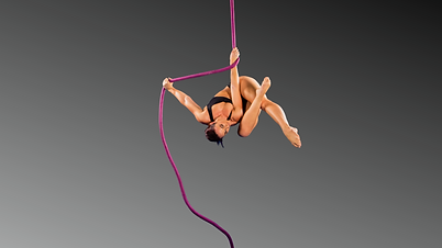 Rony Elisara suspended from aerial rope at Aerial Artistry