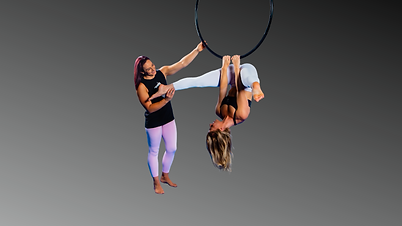 Aerial instructor coaching girl in lyra at Aerial Artistry