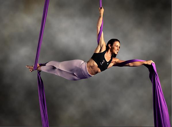 Rony Ellisara hanging from aerial silk