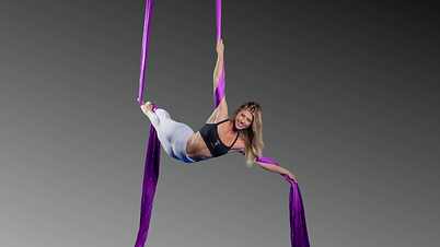 Girl suspended from aerial silks at Aerial Artistry