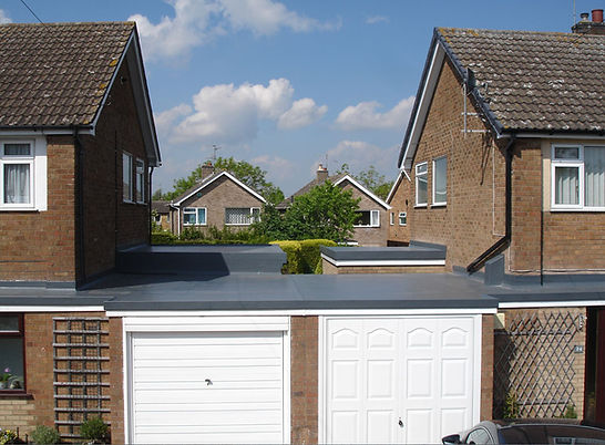 Picture of flat roofing across two properties showing the quality of our workmanship