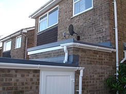 Here you can see pictures of porchways with new flat roofing and gutters fascias and soffits.