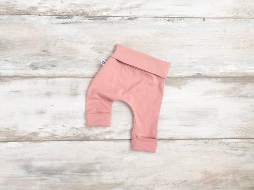 Tumši rozā bikses ar atlokāmām kāju un vidukļa manžetēm