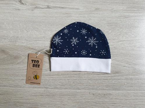 Tumši zila cepurīte ar sniegpārslām