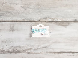 Balta matu bante ar gaiši zilu rakstu