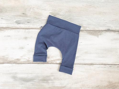 Zilas bikses ar atlokāmām jostas un kāju manžetēm