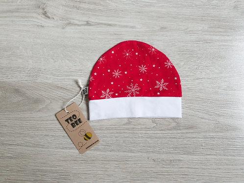Sarkana cepurīte ar sniegpārslām