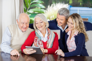 family looking at tablet