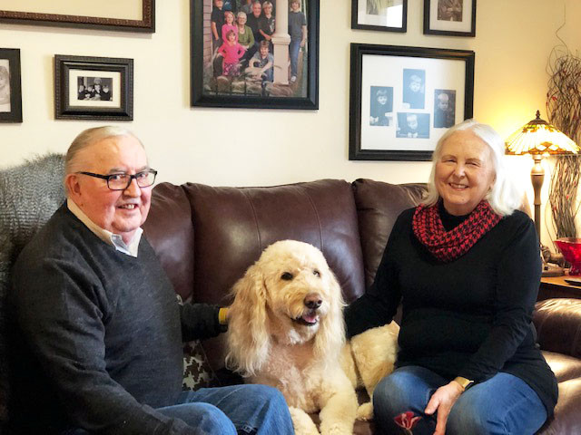 Mike and Sherry McKay and their dog Luke, who is a certified therapy dog.