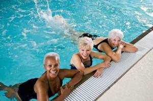 Active senior women, friends at swimming pool