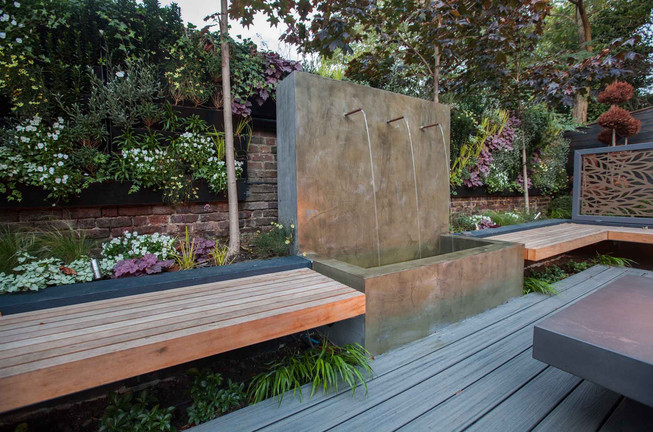 Trough water feature with water cascading from copper spouts