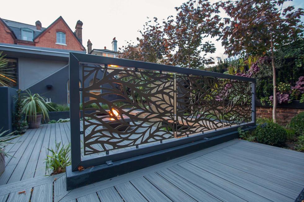 Decorative laser-cut screens in garden