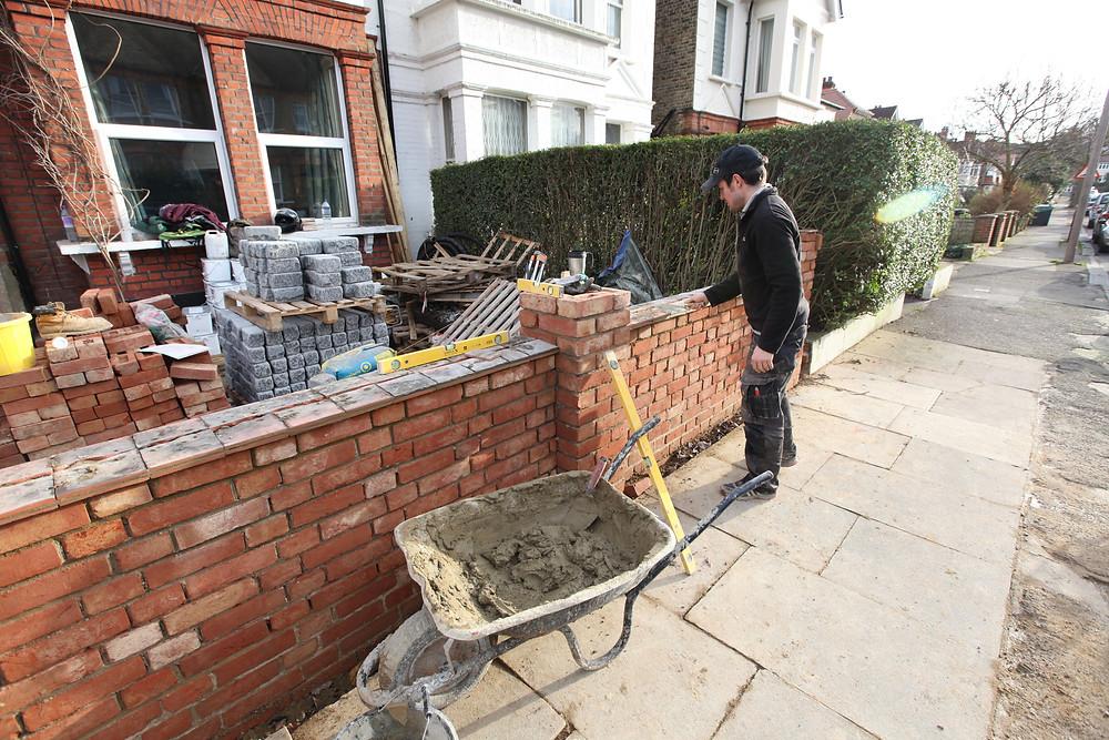 Landscape contractor building brick wall