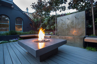 Chill-out garden with water feature and fire table
