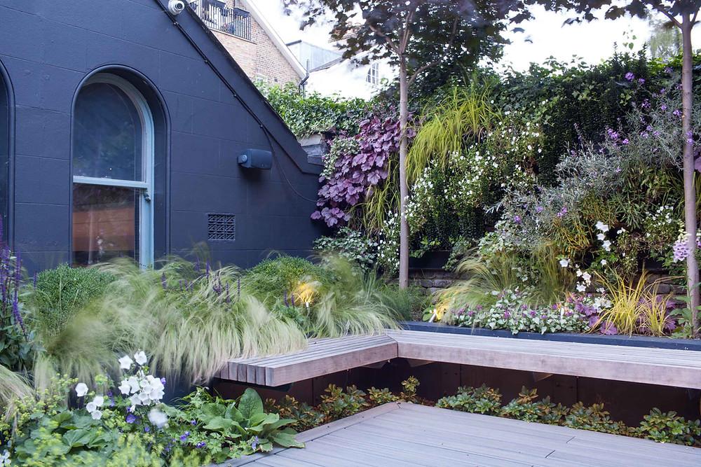 Floating hardwood garden bench by Simon Orchard Garden Design