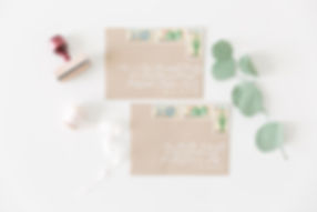 Kraft paper envelopes with white ink calligraphy for weddig invitations