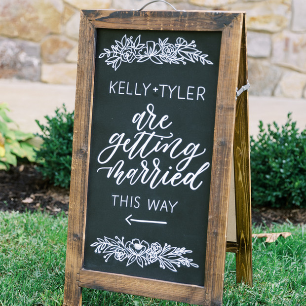 Calligraphy chalkboard sign for backyard wedding