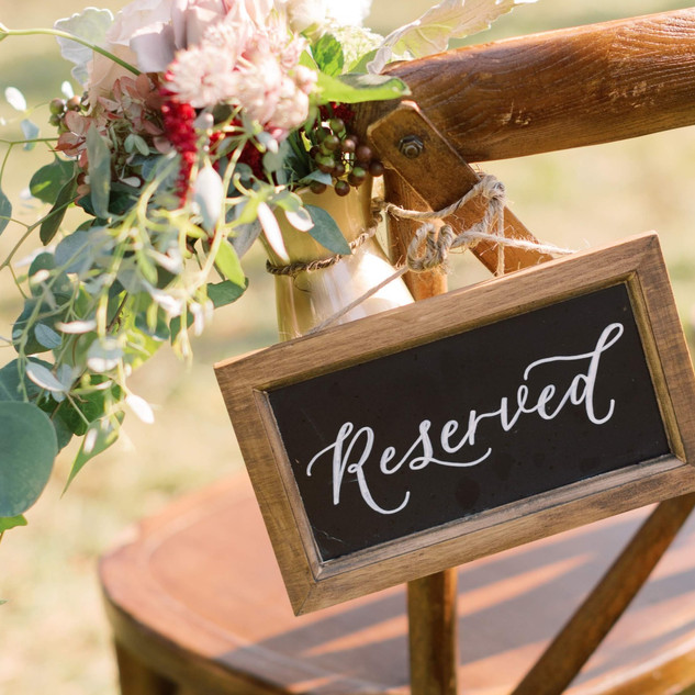 Reserved calligraphy chalkboard sign for wedding ceremony