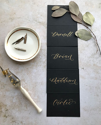 black-placecards-with-gold.jpeg