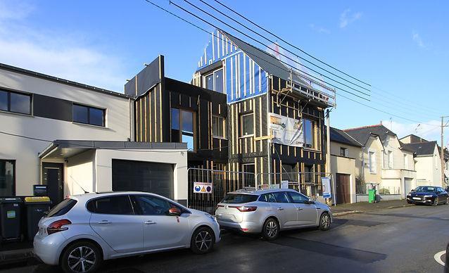 Ossature bois Rennes bardage noir architecture contemporaine