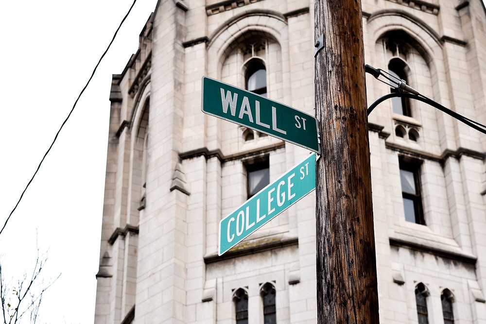 "<img src=""wallst.jpg"" alt=""street sign of wall street and college street in new york city"">"
