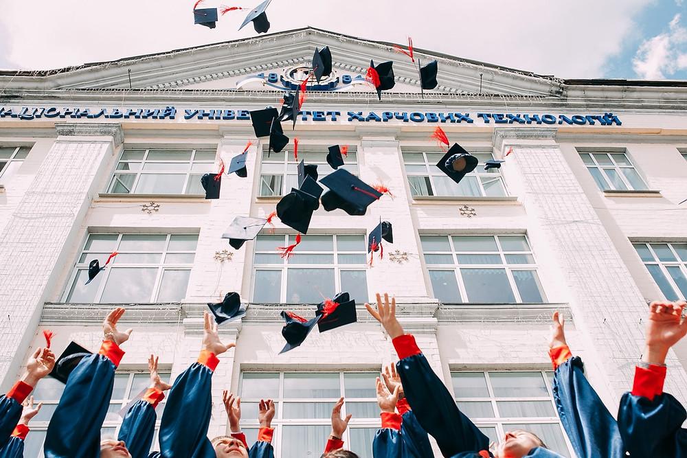 "<img src=""graduationcaps.jpg"" alt=""graduates throwing graduation caps up into the air"">"