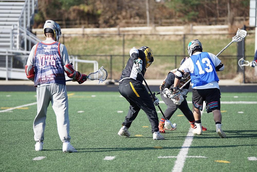 """<img src=""""sports.jpg"""" alt=""""boys playing lacrosse on field"""">"""