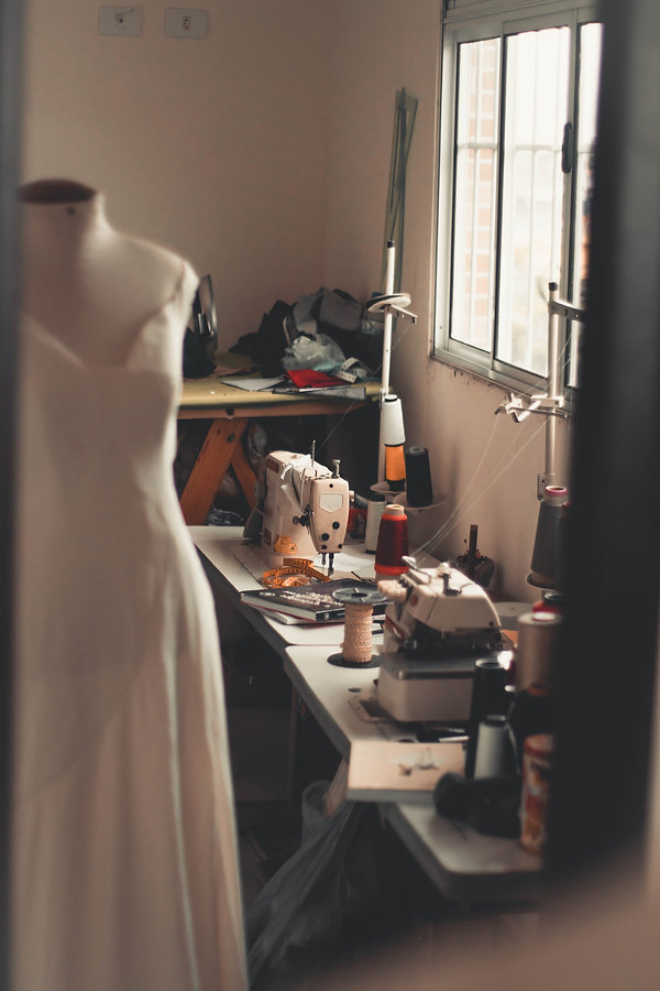 white-dress-on-mannequin-beside-white-se