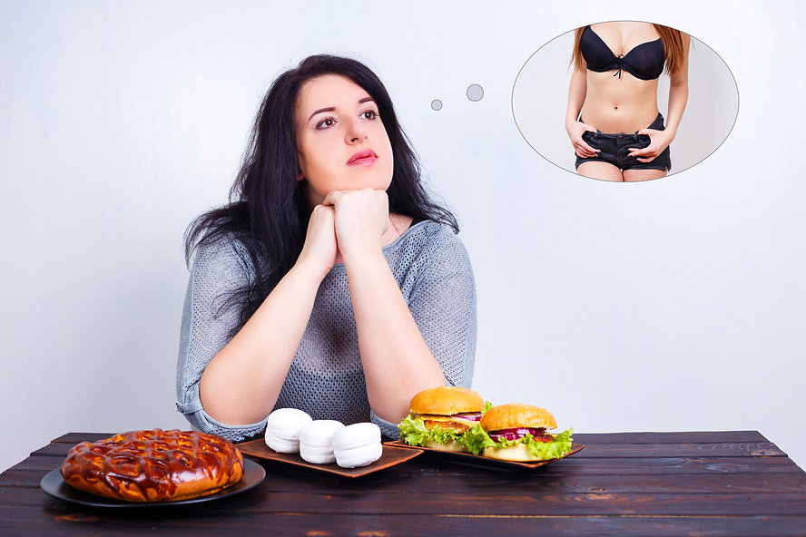Overweight obese woman with junk food dr