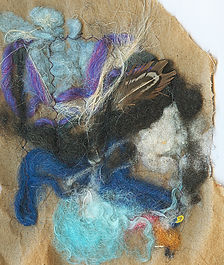 A nest made from wool, paper and feathers