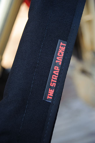 The Strap Jacket Excess Strap Control Device Close Up