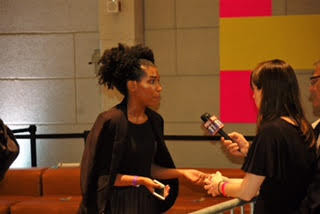 Whitney White lifestyle content creator speaking with media after her brief talk with presidential nominee.