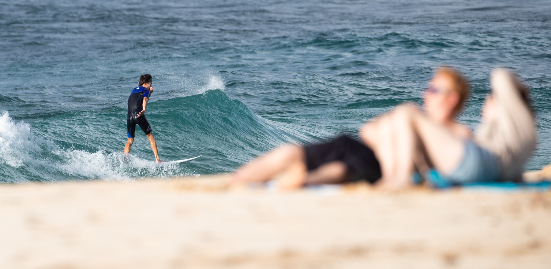 A giant's world surfer...