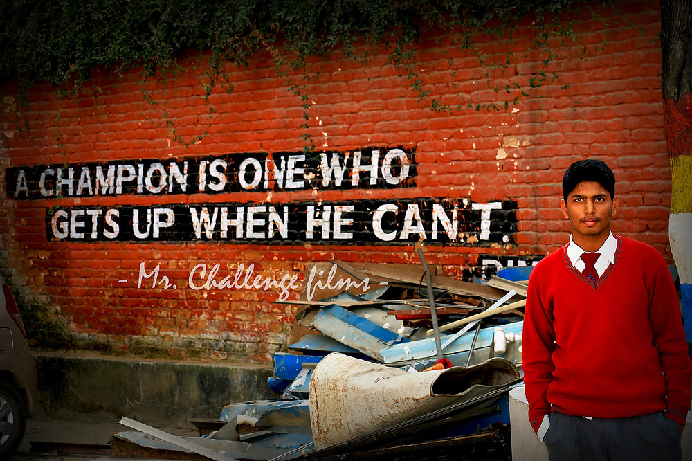 A champion is one who gets up when he cant written in the wall inspirational message