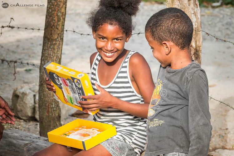 Dominican Republic children opening a present