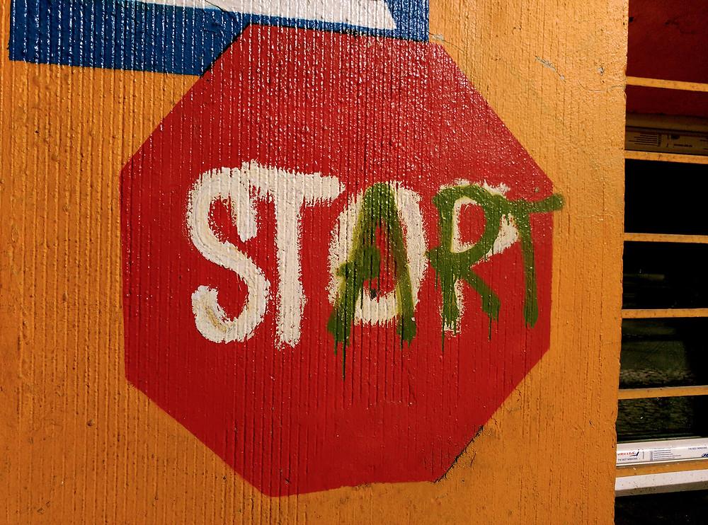 Start - Stop inspirational sign of positivism