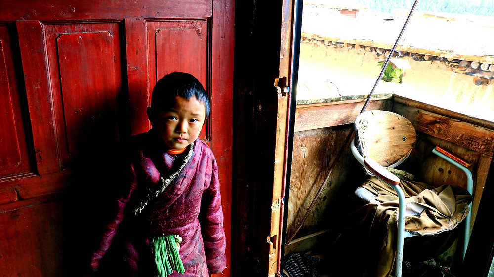 Tibetan kid at home